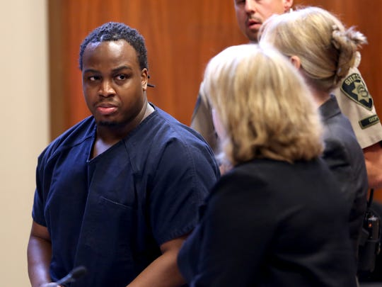 Denzel Hawthorne, 24, turns to his attorneys after hearing the sentencing decision of the court for the murder of Brett White, 44, his drug dealer's father, in August 2016. Hawthorne was sentenced to life in prison with the possibility of parole after 30 years. Photographed at the Marion County Courthouse in Salem on Wednesday, May 16, 2018.