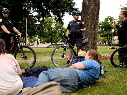 Salem Police Officers David Smith, left, and Andrew