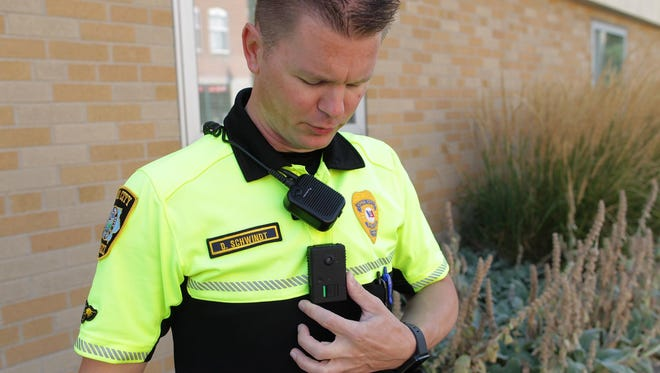 Iowa City Police Officer David Schwindt displays his body camera Aug. 13, 2015.
