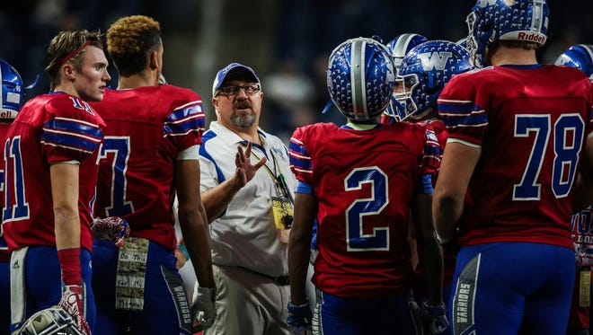 Walled Lake Western head coach Mike Zdebski talks to his team during the Division 2 state final in 2016.