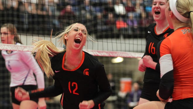 Solon's Jordan Smith celebrates a point during the Spartans' Class 3A semifinal game against Nevada at the U.S. Cellular Center in Cedar Rapids on Thursday, Nov. 13, 2014.