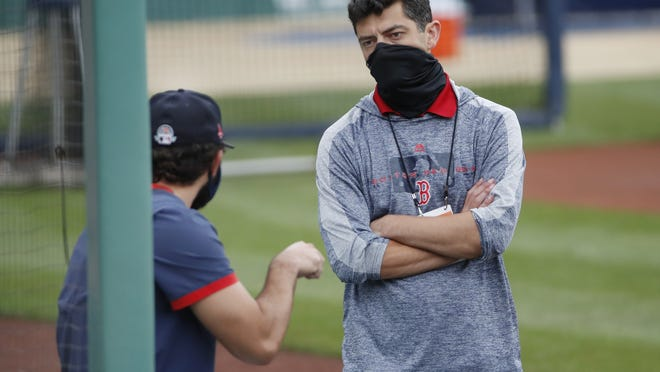 Red Sox Chief Baseball Officer Chaim Bloom (right) speaks to a player during baseball training camp at Fenway Park on July 6. Bloom told WEEI's 'Greg Hill Show' that they don't intend to stray away from the opener format.