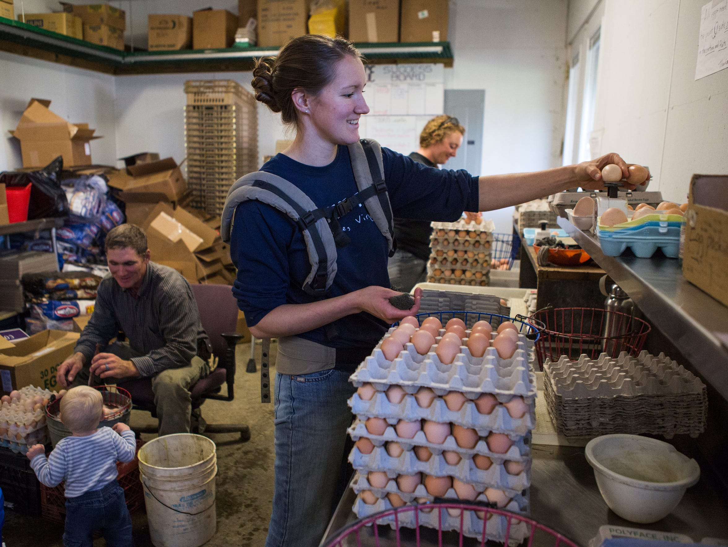 Leanna Barth cleans eggs at Polyface Farms in Swoope