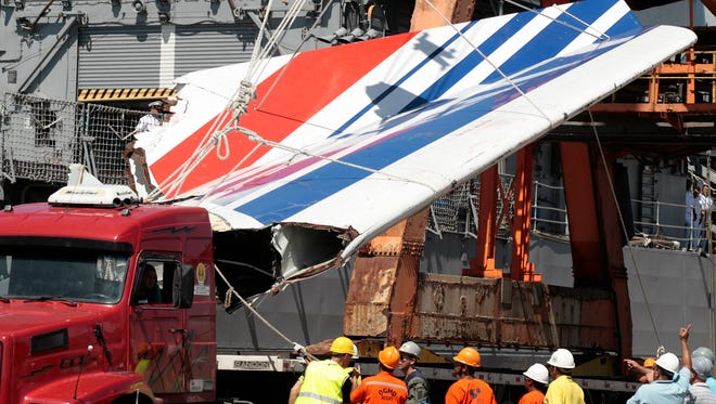 Workers recover debris from Air France 447, which plummeted into the Atlantic near Brazil.