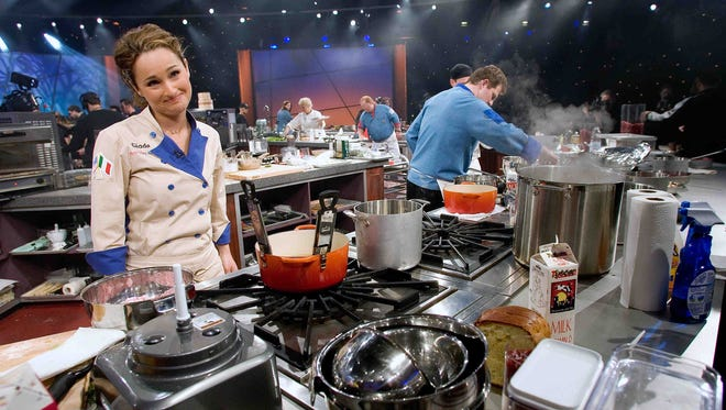 """Giada De Laurentiis is unsure of her dishes  in 2006 during a taping in New York of the Food Network series Iron Chef America. The show added a new dimension with tag-team matches.  Iron Chef Mario Batali teamed up with Rachael Ray as they battle in the """"Kitchen Stadium"""" against Iron Chef Bobby Flay and Giada De Laurentiis."""