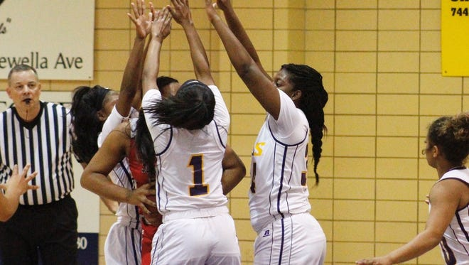 The LSUS defense swarms Southwest Thursday in the Pilots' 84-52 victory.