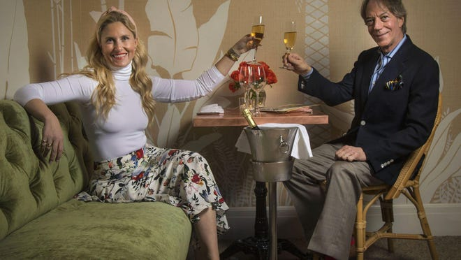 Sarah Wetenhall and Robert Caravaggi toast the New Year at the just-opened Swifty's Palm Beach at The Colony.