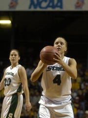Kristin Haynie, a former Mason and Michigan State basketball standout, is heading into the Greater Lansing Sports Hall of Fame this month.