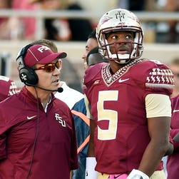 Florida State Seminoles head coach Jimbo Fisher talks with quarterback Jameis Winston (5) during the fourth quarter against the Wake Forest Demon Deacons at Doak Campbell Stadium.