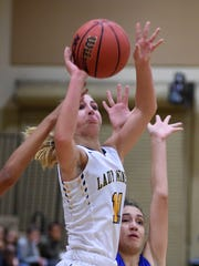 Manogue's Kenna Holt goes up to shoot against Bishop