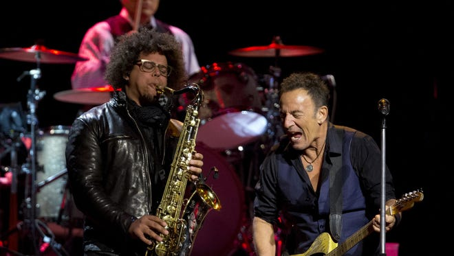 Bruce Springsteen and Jake Clemons perform Sunday at the Prudential Center in Newark.