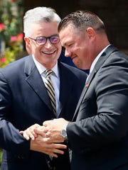 Former New Jersey Governor Jim McGreevey shakes hands with  John Brogan, CEO of Lifeline Recovery Support Services after a news conference at the Monmouth County jail to announce a new treatment program at the jail for opioid addicts. The program puts recovery coaches in touch with addicted inmates before they are released without bail under bail reform. July 31, 2018. Freehold, NJ