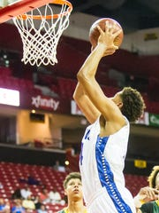 Stephen Decatur center Keve Aluma (44) goes up for a shot agianst Seneca Valley during the MPSSAA 3A semi-finals at the Xfinity Center in College Park on Thursday, March 10.