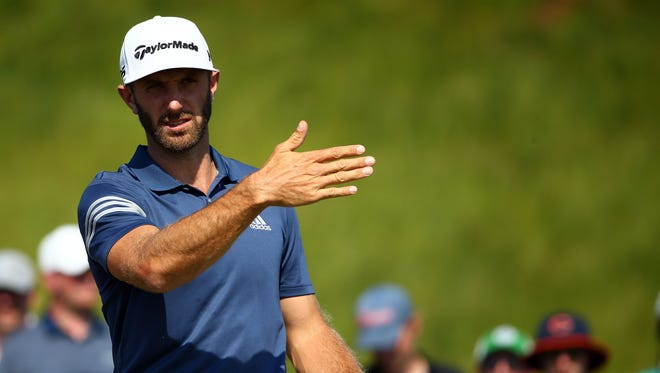 Dustin Johnson looks down the first fairway from the tee box during a practice round for the U.S. Open.