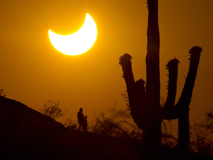 Hikers see a partial solar eclipse over Phoenix in
