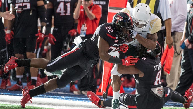 In this 2014 file photo, Texas Tech Red Raiders safety Derrick Dixon (22) makes a play against Baylor. Dixon said he's transferring to Grambling for the 2016 season.