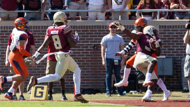 Florida state freshman running back Cam Akers (3) has a monster game with 199 rushing yards and two touchdowns as FSU holds on to win against Syracuse by a score of 27-24 at Doak Campbell Stadium in Tallahassee, Fl on Nov. 4th, 2017.