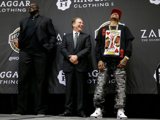 Retired NBA player Shaquille O'Neal, left, Michigan State coach Tom Izzo, center, and retired NBA player Allen Iverson laugh on stage during the Naismith Memorial Basketball Hall of Fame class of 2016 announcement, Monday,  in Houston.