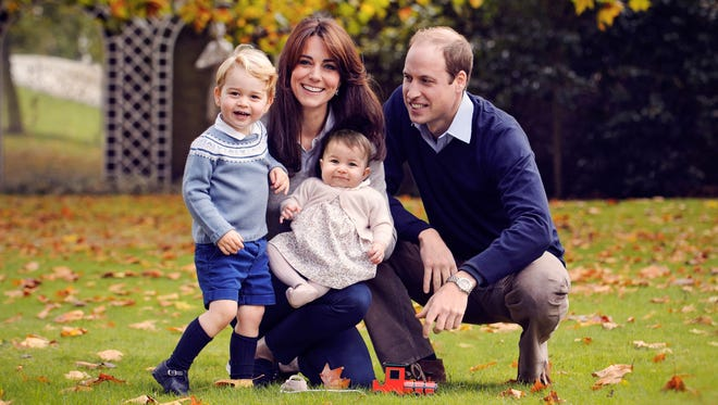 Britain's Prince William (R), Catherine, Duchess of Cambridge (2nd L) and their two children Prince George (L) and Princess Charlotte at Kensington Palace in London.
