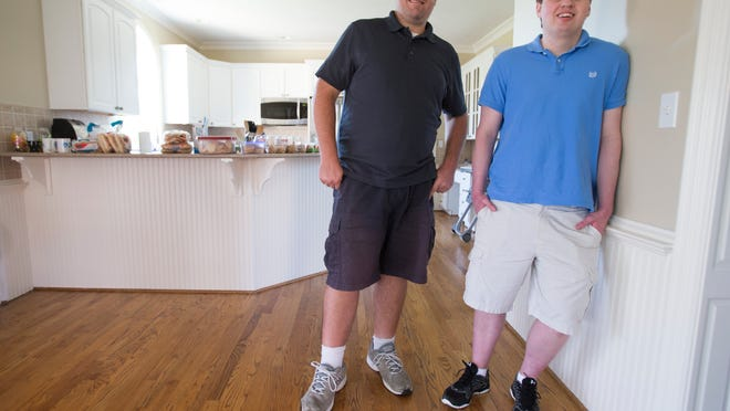 Reggie Renner (left), and his partner Mike Langin, who started Zergnet, a three-year-old startup company that helps companies build online audiences, and has employees that largely work out of their homes, Sunday, September 14, 2014.