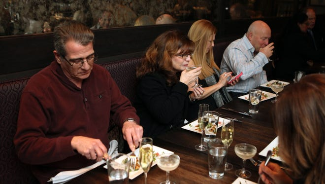 Sweepstakes winners Bob and Louisa Forese from Pomona and Lisa Verducci and Bill Hahn from Park Ridge, N.J. enjoy the meal at the Fried Chicken and Champagne dinner at D'Vine Bar in Sparkill, Jan 26, 2016.