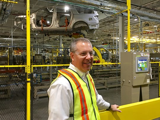 "Joe Hinrichs, president, global operations at Ford, is standing in front of the ""Kong"" robot moving SUV bodies in the Ford Kentucky Truck Plant in Louisville, KY on Feb. 9, 2018."
