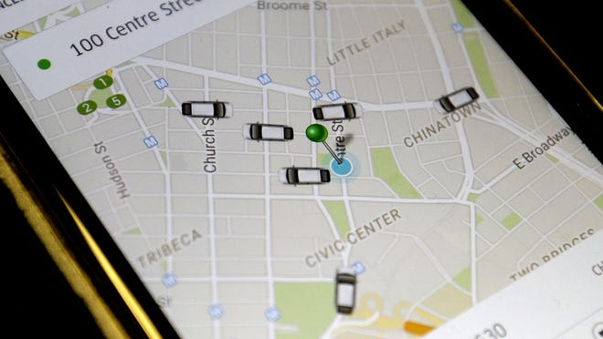The Uber app displays cars available to make a pickup in downtown Manhattan on a smartphone.