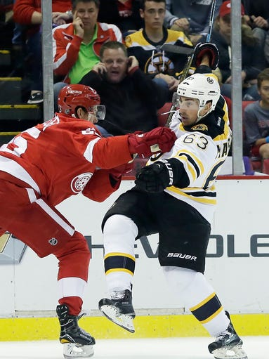 Detroit Red Wings defenseman Danny DeKeyser, left,