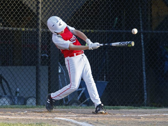 T.J. Drums of Ocean hits a single against South Wall