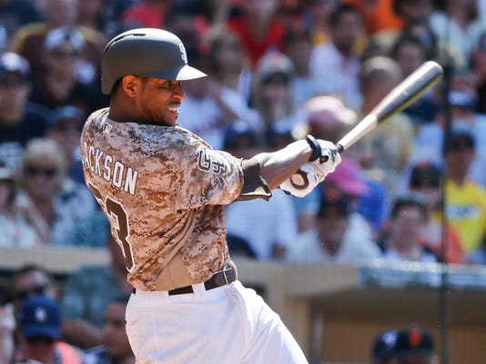 San Diego Padres pitcher Edwin Jackson hits a run-producing base hit to center field against the San Francisco Giants in the sixth inning of a baseball game Sunday, July 17, 2016, in San Diego. (AP Photo/Lenny Ignelzi)