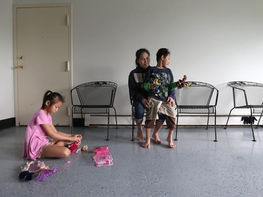 Mu Mu, with son Jobmu, 6, and daughter Ju Aye, 9, is one of 6,000 to 7,000 Burmese refugees who have settled in Iowa.
