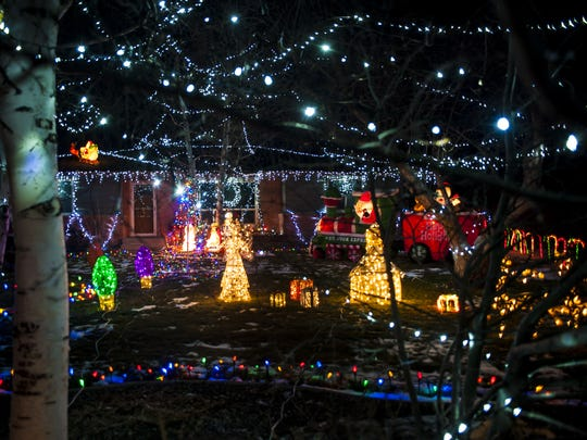 Christmas lights cover the yard at 1907 Dahlia Court.