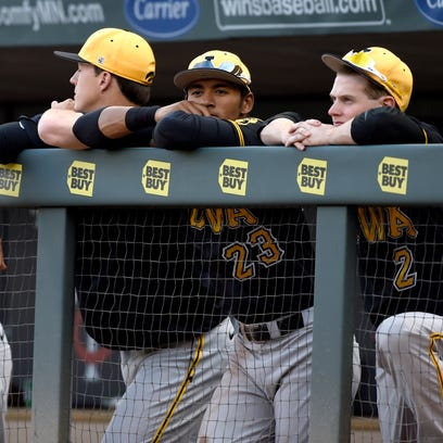 Iowa watches from the dugout during the ninth inning of a third-round NCAA Big Ten tournament college baseball game against Indiana Friday, May 22, 2015, in Minneapolis. Indiana won 10-2. (AP Photo/Hannah Foslien)