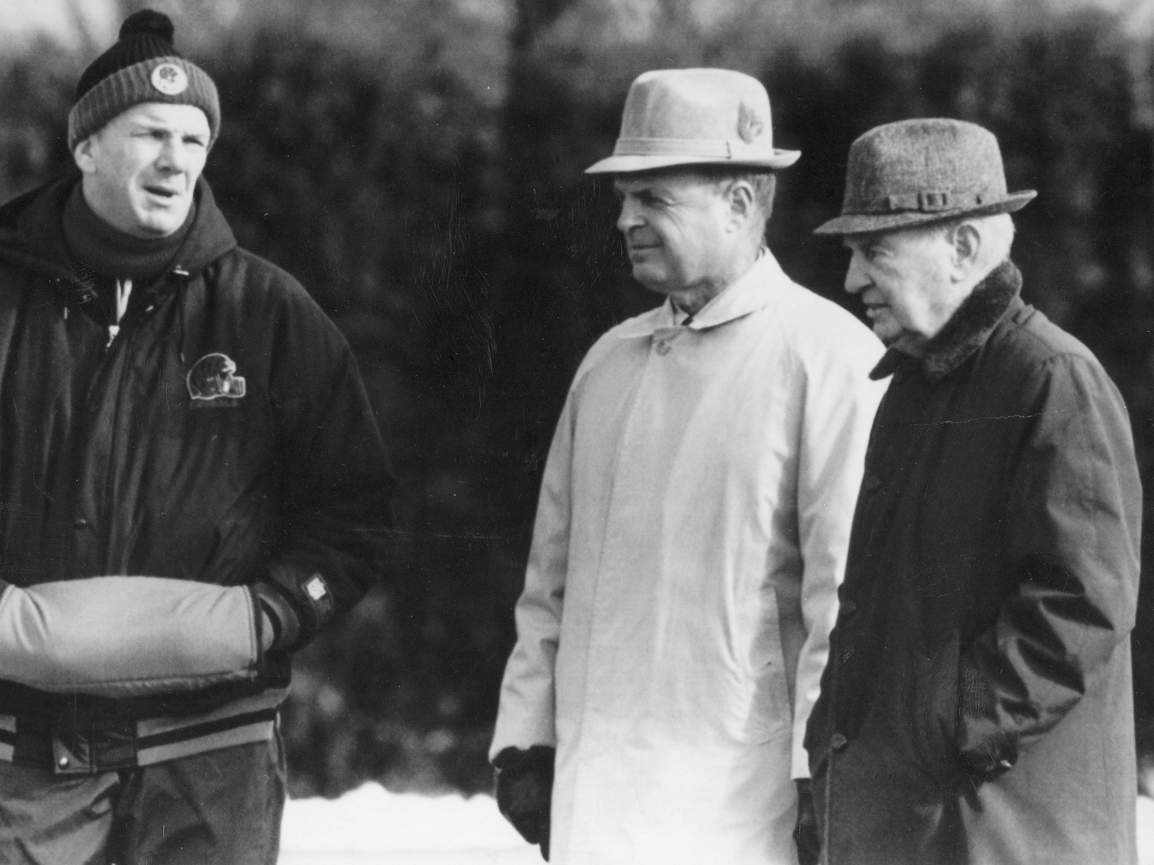 DECEMBER 13, 1989: Checking Progress - Cincinnati Bengals coach, Sam Wyche, talks with team executives, Mike Brown, center, and Paul Brown, during practice at Spinney Field in Cincinnati. Associated Press Scanned 6/12/2017