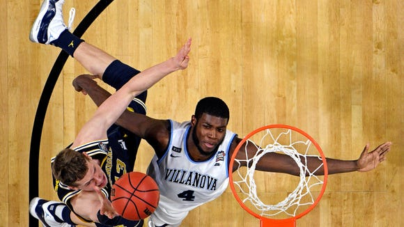 Michigan Wolverines forward Moritz Wagner (13) shoots the ball against Villanova Wildcats forward Eric Paschall (4) during the second half in the championship game of the 2018 men's Final Four at Alamodome,