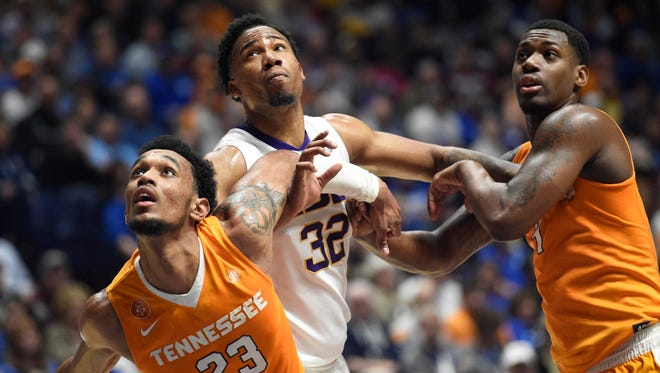 LSU Tigers forward Craig Victor II (32) battles for positioning with Tennessee Volunteers forward Derek Reese (23) and forward Armani Moore (4) in fie first half during the SEC tournament at Bridgestone Arena.