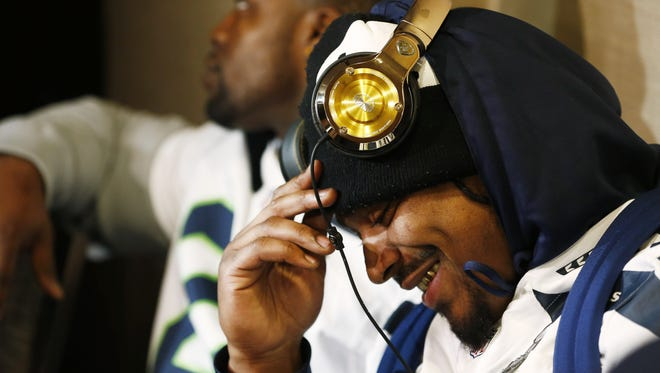 Seahawks RB Marshawn Lynch offers a brief smile Wednesday.