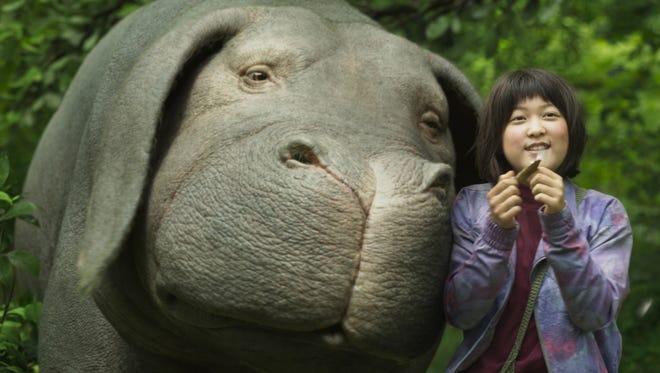 "Mija (Seo-Hyun Ahn) raises a ""super pig"" in the mountains of South Korea in whimsical sci-fi adventure 'Okja.'"