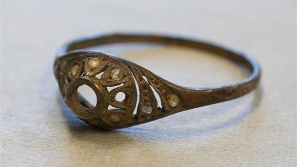 This ring and a necklace were found hidden in a false-bottomed