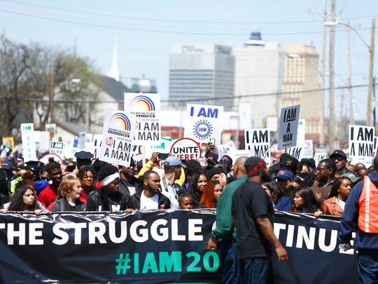 Marchers make their way through Memphis during the I Am A Man march to commemorate the 50th Anniversary of Martin Luther King Jr.'s assassination Wednesday, April 4, 2018, in Memphis, Tenn.