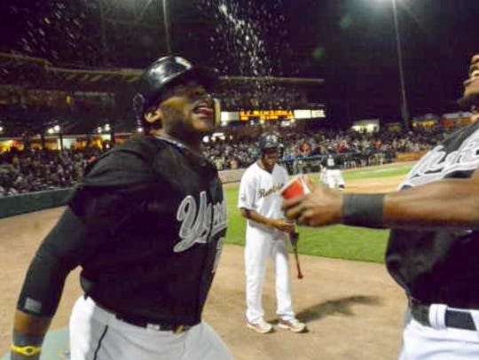 Telvin Nash is splashed with water after his go-ahead,