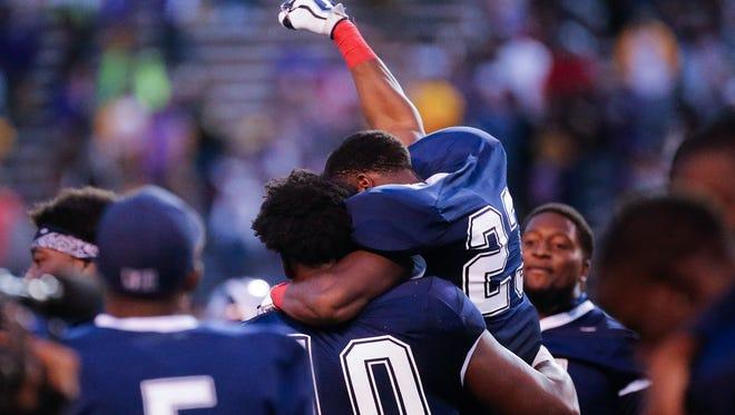 Jackson State teammates Romello Shoemake (23) and Malik Hamner (10) celebrate following the Tiger's 7-3 win over Alcorn Saturday in Jackson.