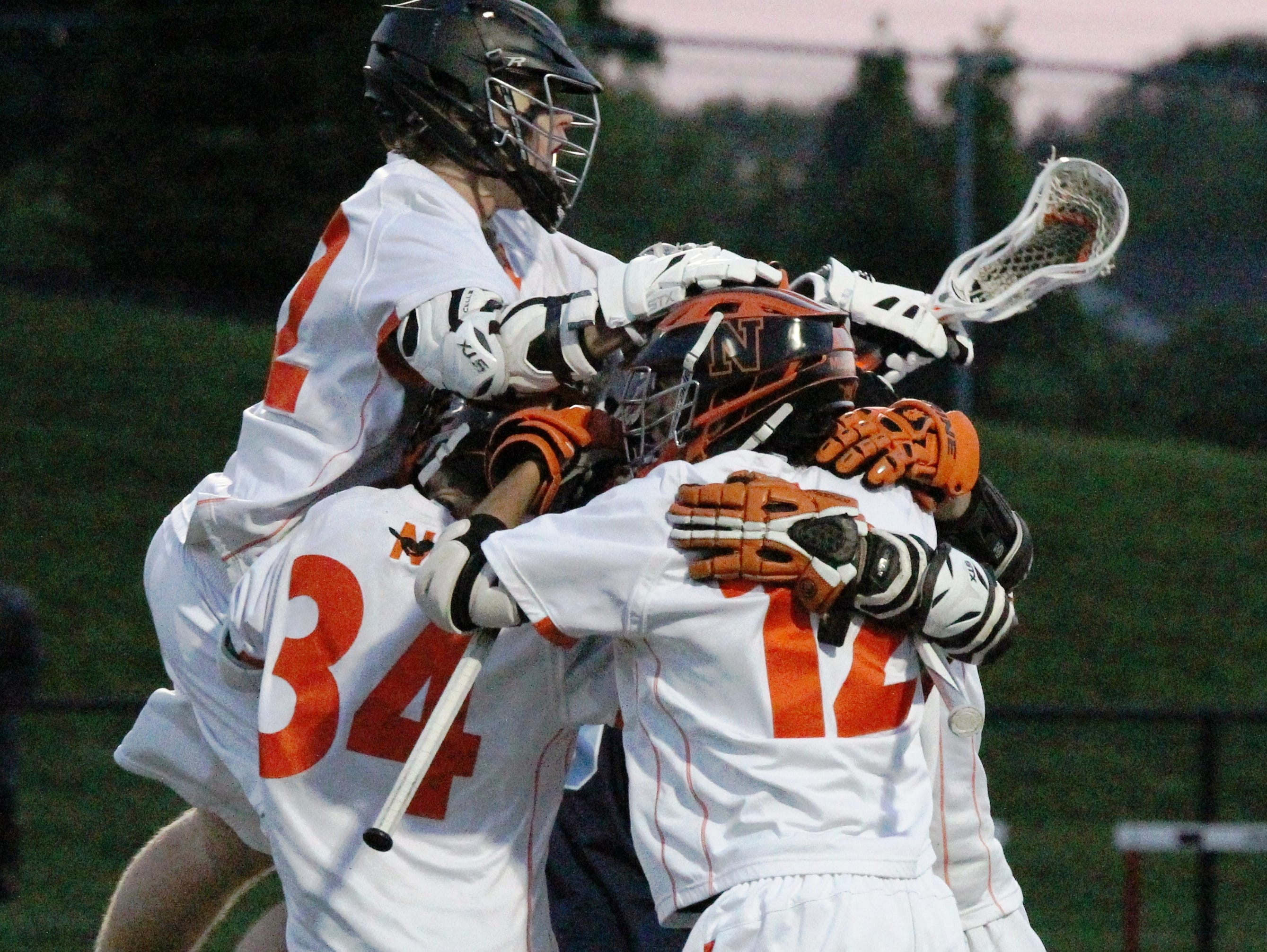 Northville players celebrate their regional semifinal win over Ann Arbor Skyline.