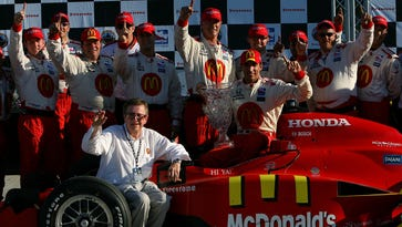 Carl Haas, seated, celebrates with driver Justin Wilson and his Newman Haas Lanigan Racing crew after Wilson won the the IRL Detroit Indy Grand Prix in 2008.