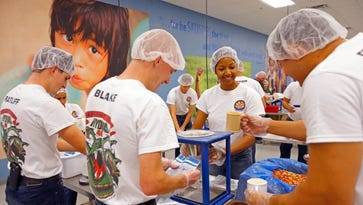Yuma Police Recruit Vanessa Edwards joins other recruits as they volunteer at Feed My Starving Children in 2015.