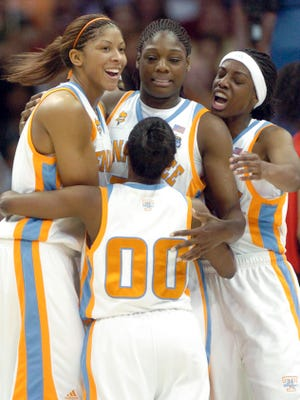 From left, Lady Vols Candace Parker, Shannon Bobbitt and Alberta Auguste surround Nicky Anosike, center, after she was fouled while scoring during the national championship game against Rutgers in 2007.
