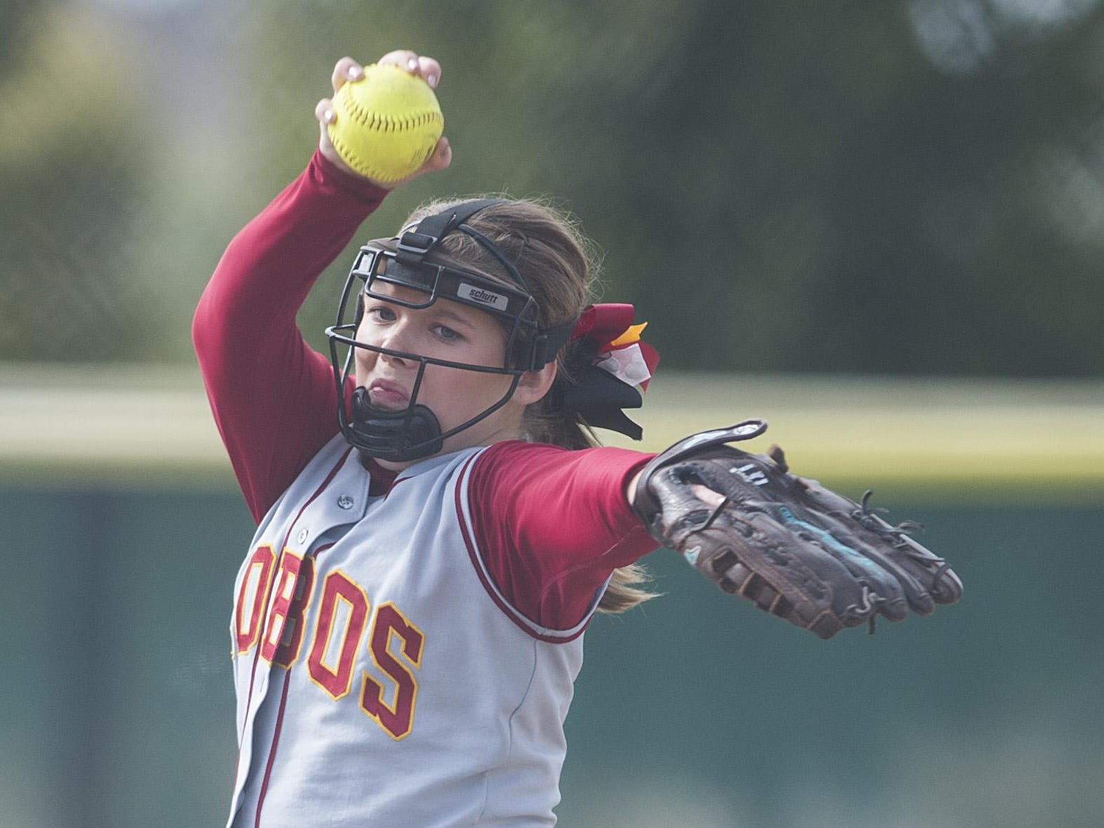 Rocky Mountain pitcher Kelly Schueler delivers the ball to a Fossil Ridge batter during a game at Fossil Ridge High School Saturday, October 3, 2015. The Lobos defeated the SaberCats 7-1.