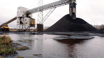 In this March 9, 2006, photo, a conveyor belt moves underground mined coal to the surface at Peabody Energy's Gateway near Coulterville, Ill. The bankruptcy filing of Peabody Energy raises yet more questions about the ability of financially troubled coal companies to cover the potential cost of filling in mines that close.