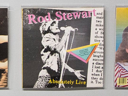 "Rod Stewart's ""Absolutely Live"" hangs among many covers, designed by Margo Nahas and Jay Vigon, on a wall near their studio spaces on the fourth floor of the Mainframe Studios on Monday, April 30, 2018, in Des Moines."