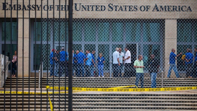 Staff stand within the United States embassy facility Sept. 29, 2017 in Havana, Cuba. The terrifying attacks in Cuba overwhelmingly hit U.S. intelligence operatives in Havana, not ordinary diplomats, when they began within days of President Donald Trump's election.